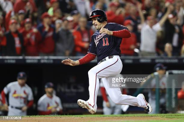 Ryan Zimmerman of the Washington Nationals scores a run in the first inning against the St Louis Cardinals during game four of the National League...