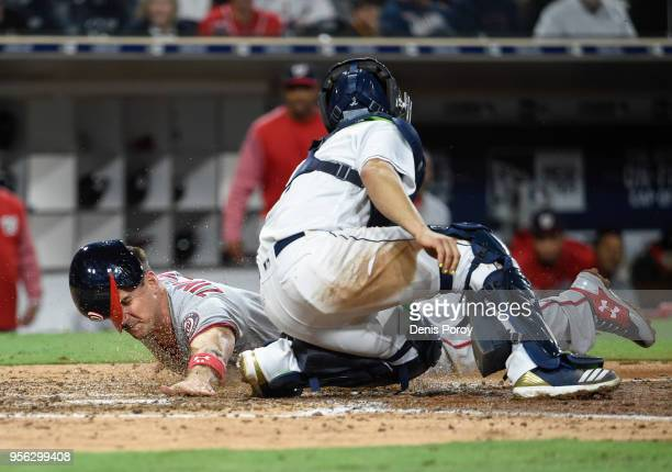 Ryan Zimmerman of the Washington Nationals scores ahead of the tag of Raffy Lopez of the San Diego Padres during the ninth inning of a baseball game...