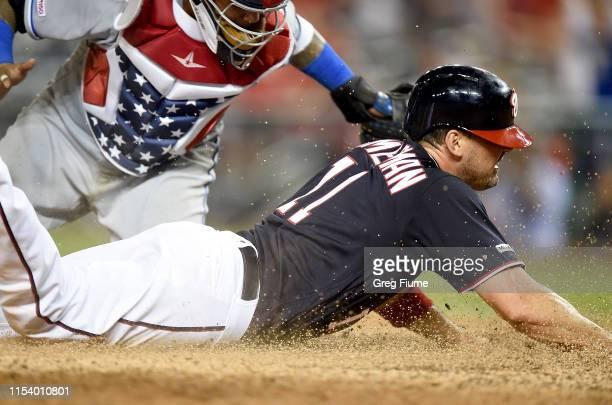 Ryan Zimmerman of the Washington Nationals scores in the ninth inning ahead of the tag of Martin Maldonado the Kansas City Royals at Nationals Park...
