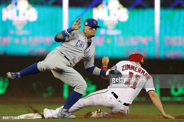 Ryan Zimmerman of the Washington Nationals slide into second safely under the tag of Javier Baez of the Chicago Cubs in the fifth inning during game...