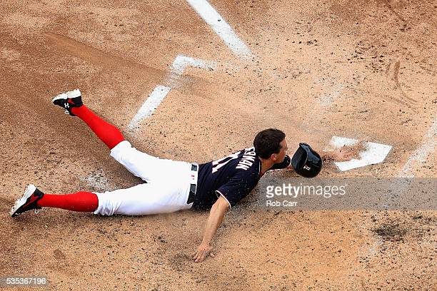 Ryan Zimmerman of the Washington Nationals slides into home to score a run in the fourth inning against the St Louis Cardinals at Nationals Park on...
