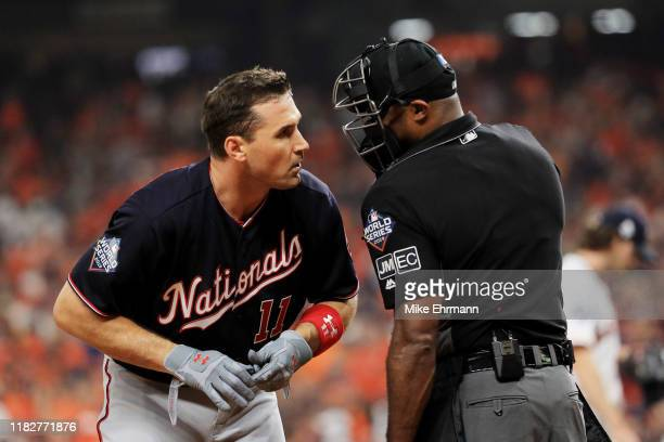 Ryan Zimmerman of the Washington Nationals speaks with umpire Alan Porter after striking out against the Houston Astros during the fourth inning in...