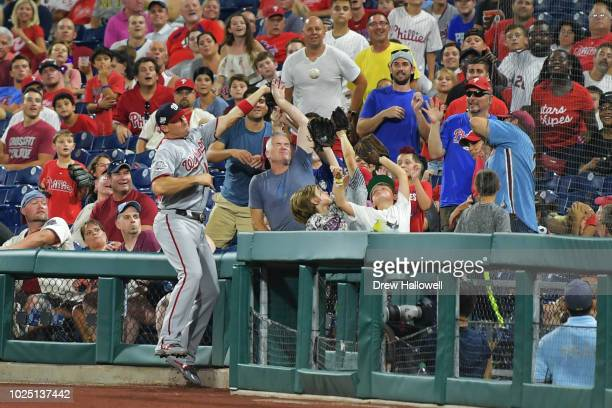 Ryan Zimmerman of the Washington Nationals tries to catch a foul ball into the crowd in the fifth inning against the Philadelphia Phillies at...