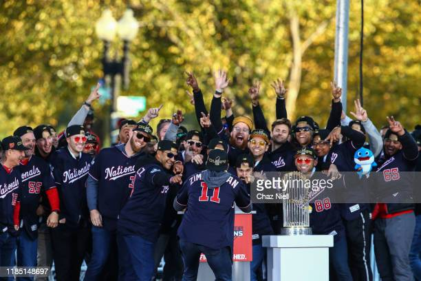 Ryan Zimmerman takes a team photo of his team mates on stage during the World Series victory celebration on November 02 2019 in Washington DC