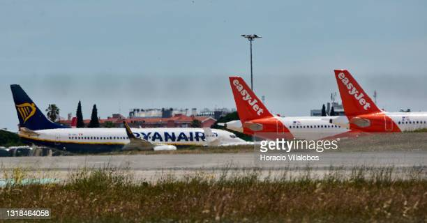 Ryanair and EasyJet airplanes sit on the tarmac in Humberto Delgado International Airport during the first day of new travel regulations between...