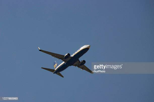 Ryanair Boeing 737-800 aircraft flying over Thessaloniki city. The low cost carrier fly an all Boeing fleet with the specific airplane with...