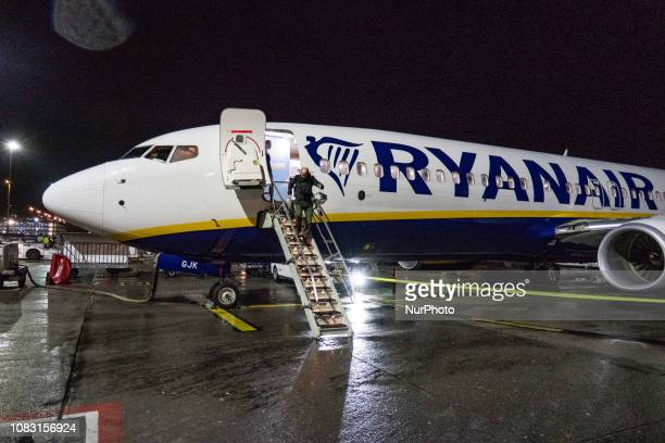 A Ryanair Boeing 737800 aircraft with registration EIGJK parked at Eindhoven airport tarmac at night in the Netherlands Passengers are disembarking...