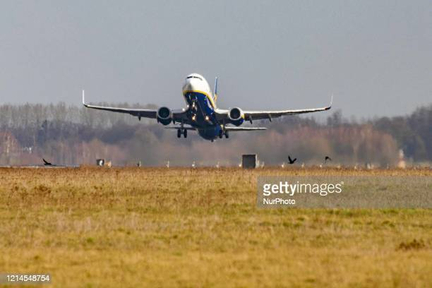 A Ryanair Boeing 737800 commercial aircraft as seen during takeoff rotating and flying off the runway at Eindhoven EIN EHEH airport in the...