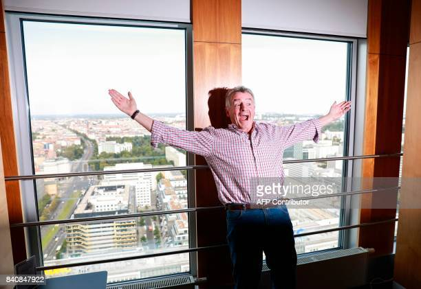 Ryanair CEO Michael O'Leary who has expressed an interest in buying up parts of insolvent Air Berlin reacts as he poses for the media during a press...