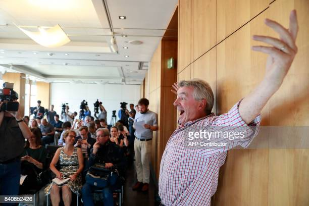 Ryanair CEO Michael O'Leary who has expressed an interest in buying up parts of insolvent German airline Air Berlin poses for photographers and...