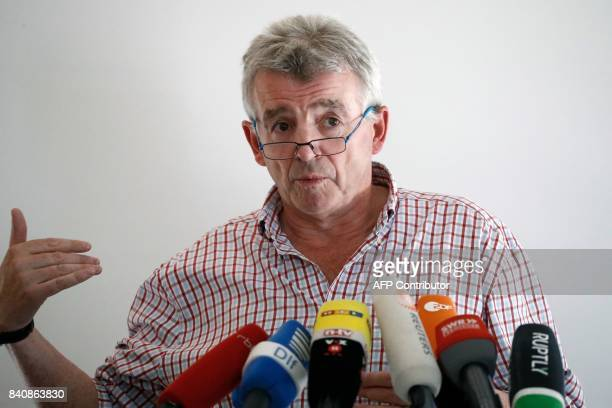 Ryanair CEO Michael O'Leary who has expressed an interest in buying up parts of insolvent German airline Air Berlin gives a press conference in...