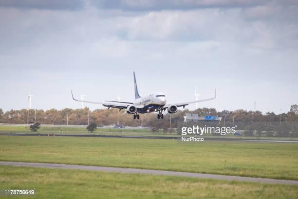 Ryanair low cost carrier, Boeing 737-8AS aircraft as seen on final approach landing on Polderbaan runway 18R/36L at Amsterdam Schiphol International...