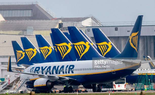 "Ryanair passenger jets are seen on the tarmac at Dublin airport on March 23, 2020. - Ryanair will cancel ""most if not all"" of its flights from next..."