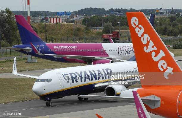 RyanAir passenger plane taxis past planes of other discount airliners Wizz Air and EasyJet at Schoenefeld Airport near Berlin during a 24hour strike...