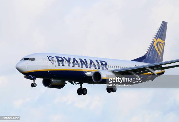 A Ryanair plane lands at Dublin Airport on September 21 2017 Ryanair chief executive Michael O'Leary on September 21 said he could not rule out axing...