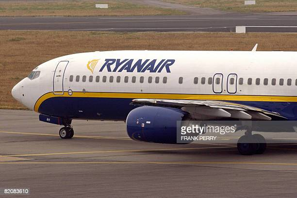 A Ryanair plane taxis on the runway in Nantes in western France 15 September 2005 Irish lowcost airline Ryanair said on Monday July 28 that net...