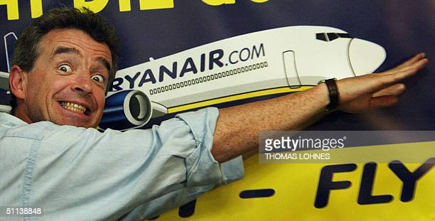 Ryanairchairman Michael O'Leary gestures in front of an advertisement of his Irish nofrills airline during a press conference in the western town of...