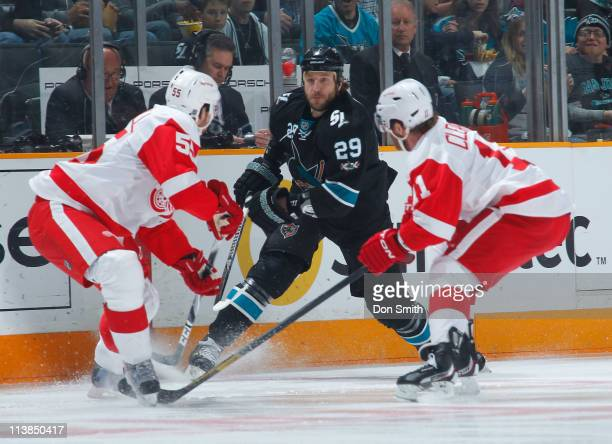 Ryane Cl2owe of the San Jose Sharks gets the puck behind the net against Danny Cleary and Niklas Kronwall of the Detroit Red Wings in Game Five of...