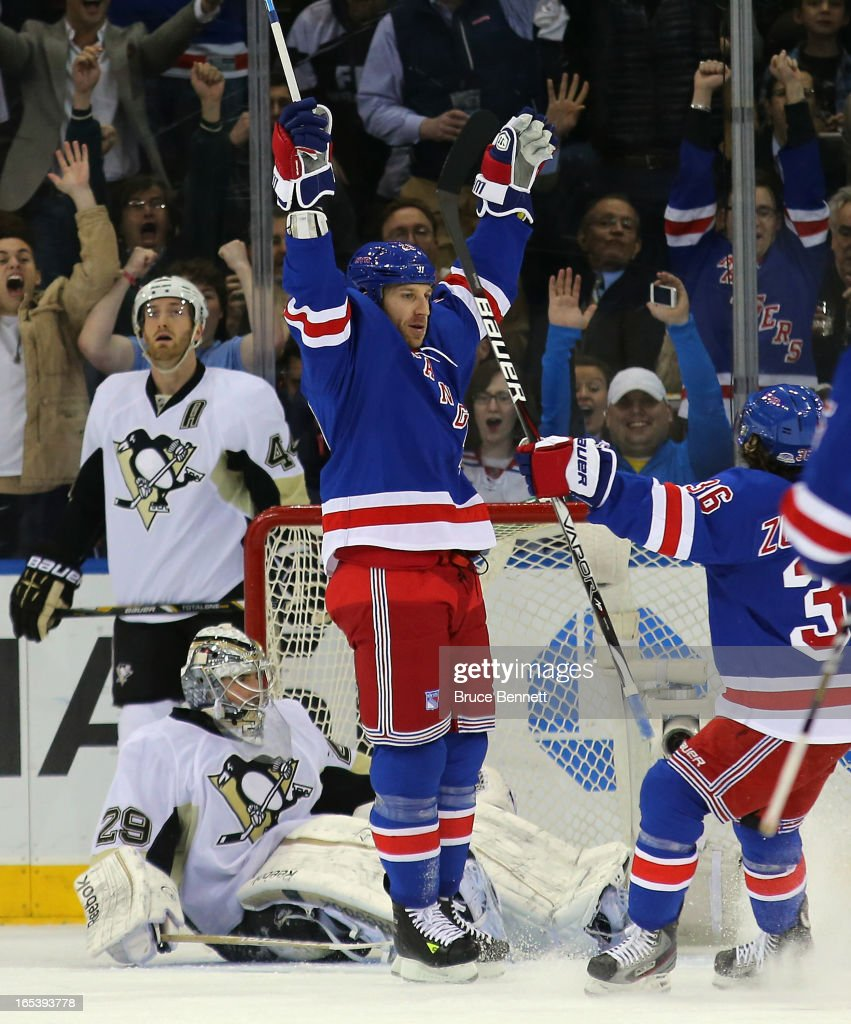Ryane Clowe #29 of the New York Rangers celebrates his first goal as a Ranger and first goal of the season at 14:19 of the first period against Marc-Andre Fleury #29 of the Pittsburgh Penguins at Madison Square Garden on April 3, 2013 in New York City.