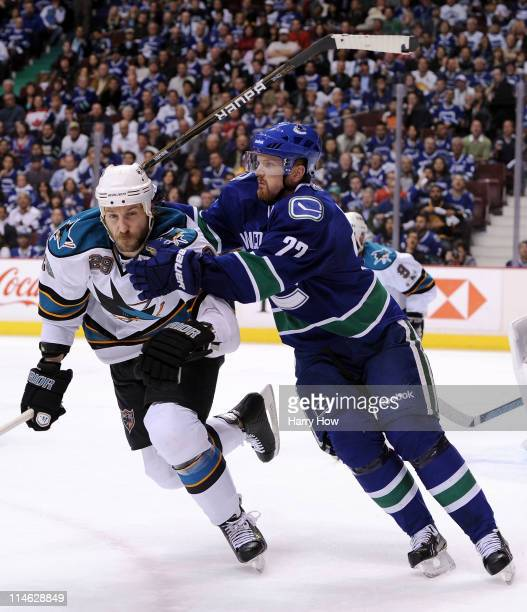 Ryane Clowe of the San Jose Sharks and Daniel Sedin of the Vancouver Canucks vie for position in the second period in Game Five of the Western...