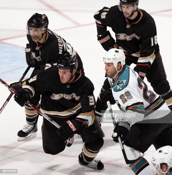 Ryane Clowe of the San Jose Sharks defends against James Wisniewski, Scott Niedermayer and Drew Miller of the Anaheim Ducks during Game Four of the...