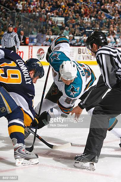 Ryane Clowe of the San Jose Sharks faces off against Tim Connolly of the Buffalo Sabres during the game on February 13 2009 at HSBC Arena in Buffalo...