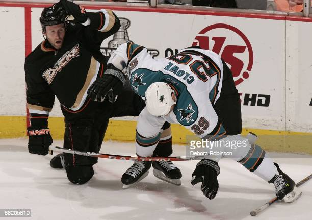 Ryane Clowe of the San Jose Sharks gets tripped up with Ryan Whitney of the Anaheim Ducks during Game Four of the Western Conference Quarterfinal...
