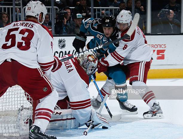 Ryane Clowe of the San Jose Sharks looks for a rebound against Matthew Lombardi Derek Morris and Jason LaBarbera of the Phoenix Coyotes during an NHL...