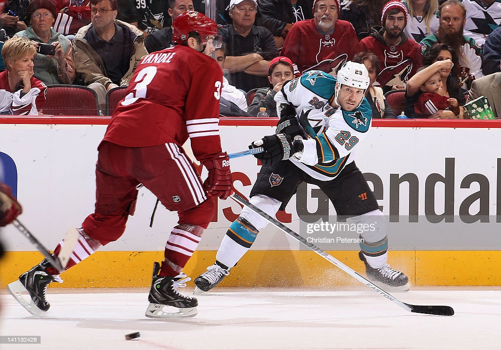 Ryane Clowe #29 of the San Jose Sharks shoots the puck past Keith Yandle #3 of the Phoenix Coyotes during the NHL game at Jobing.com Arena on March 10, 2012 in Glendale, Arizona. The Coyotes defeated the Sharks 3-0.
