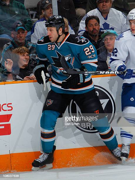 Ryane Clowe of the San Jose Sharks watches the puck against the Toronto Maple Leafs during an NHL game on January 11, 2011 at HP Pavilion at San Jose...