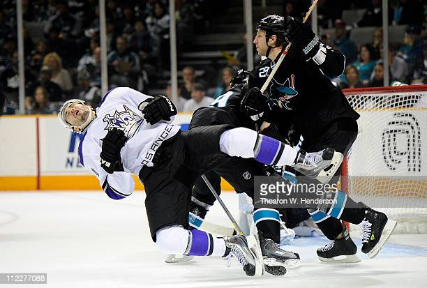 Ryane Clowe the San Jose Sharks gets a penalty for cross checking Drew Doughty of the Los Angeles Kings in Game Two of the Western Conference...