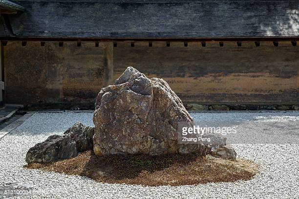 Ryanji dry gardenThe clay wall which is stained by age with subtle brown and orange tones reflects wabi and the rock garden sabi together reflecting...