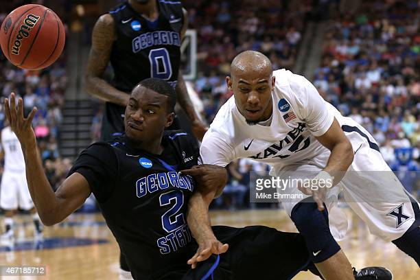 Ryann Green of the Georgia State Panthers and Myles Davis of the Xavier Musketeers battle for a loose ball in the second half during the third round...