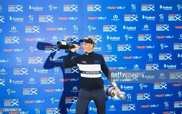 Ryann O'Toole of The United States enjoys a light-hearted moment as she raises a bottle of champagne at the official torphy presentation after her...