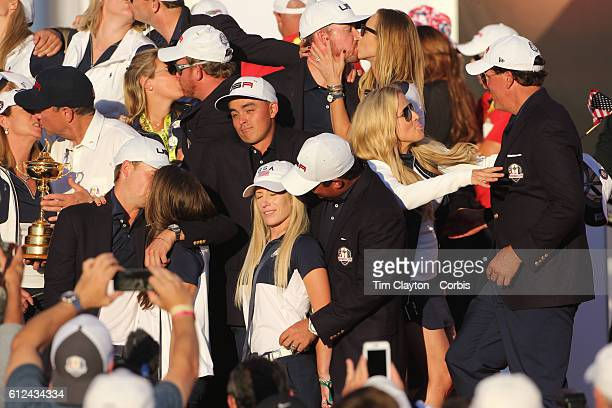 Ryder Cup 2016. Day Three. The United States team players and their spouses and partners celebrate with the Ryder Cup after the United States victory...