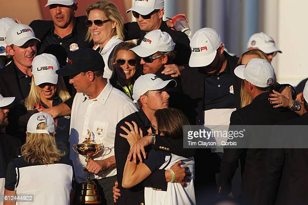 Ryder Cup 2016 Day Three The United States team players and their spouses and partners celebrate with the Ryder Cup after the United States victory...