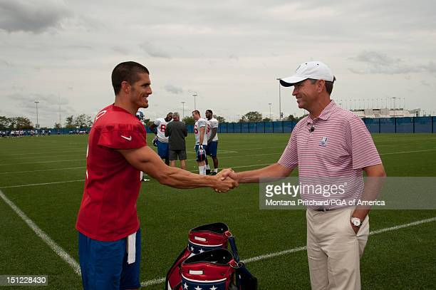 Ryder Cup Captain Davis Love III shakes hands with New York Giants player David Carr at Timex Performance Center on September 3 2012 in East...