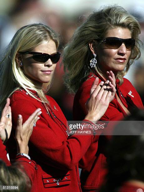 Ryder Cup captain Hal Sutton's wife Ashley Sutton and Tiger Woods' fiancee Elin Nordegren clap for their team at the opening ceremonies of the Ryder...