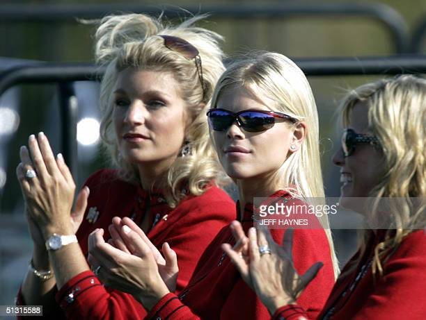 Ryder cup captain Hal Sutton's wife Ashley Sutton Tiger Woods' fiancee Elin Nordegren and the wife of Phil Mickelson Amy clap for their team at the...
