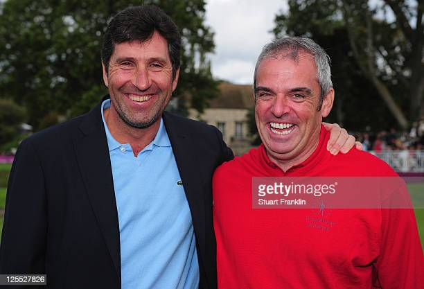 Ryder Cup captain Jose Maria Olazabal congratulates Paul McGinley captain of the Great Britain and Ireland team after the final day's singles matches...