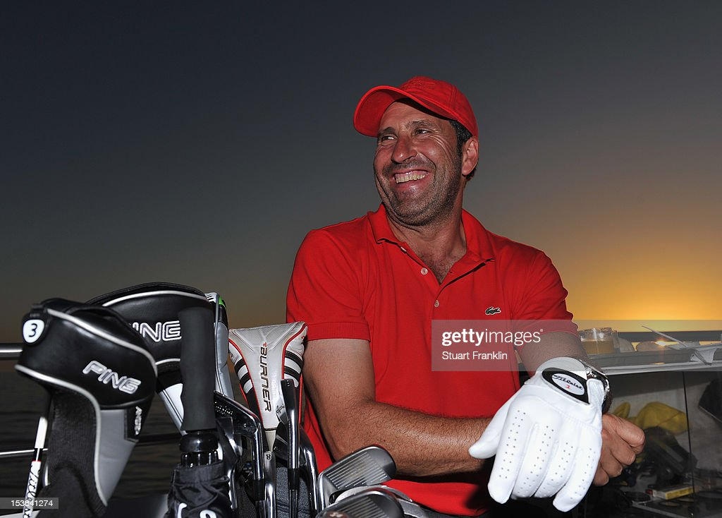 Ryder Cup captain Jose Maria Olazabal of Spain looks on as players hit a shot from a boat to a target on a small boat prior to the start of the Portugal Masters golf on October 9, 2012 in Faro, Portugal.
