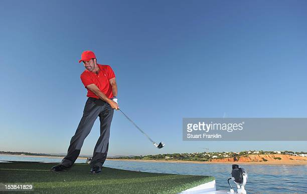 Ryder Cup captain Jose Maria Olazabal of Spain plays a shot from a boat to a target on a small boat prior to the start of the Portugal Masters golf...
