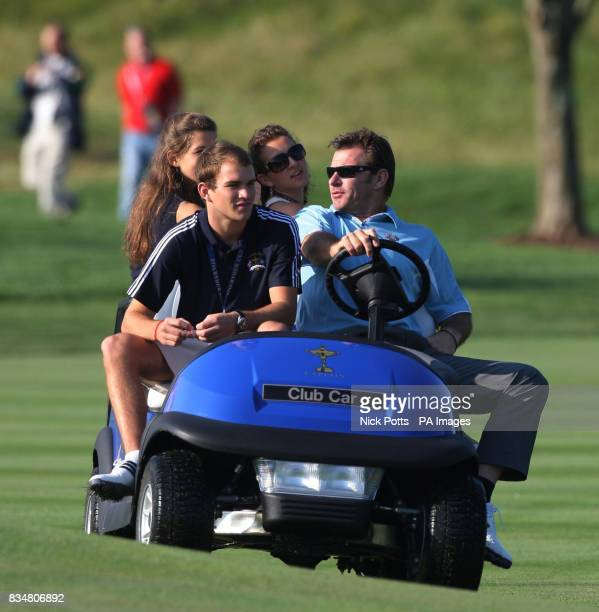 Ryder Cup Captain Nick Faldo with his son Matthew and daughter's Natalie and Georgia watches the Europe team practise from the buggy at Valhalla Golf...