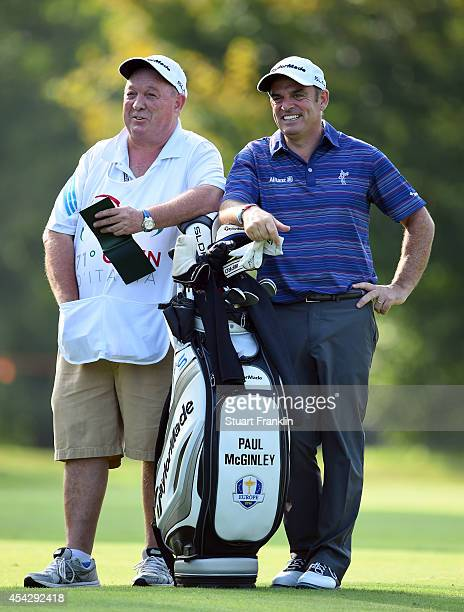 Ryder Cup Captain Paul McGinley of Ireland and caddie share a joke during the first round of the 71st Italian Open Damiani at Circolo Golf Torino on...