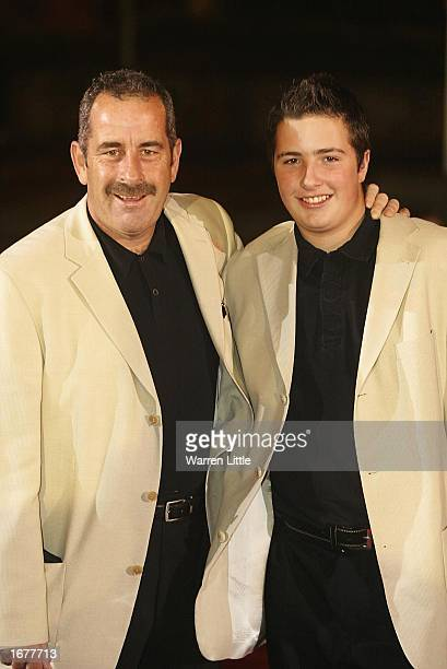 Ryder Cup captain Sam Torrance poses with his son as they arrive for the BBC Sports Personality of the Year Awards held at the BBC Television Centre...