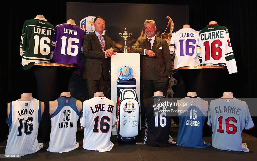 Ryder Cup Captains Davis Love III (left) and Darren Clarke pose with the Ryder Cup trophy and shirts of Minnesota's five professional sports teams during the 2016 Ryder Cup 'Welcome To Minnesota' Breakfast at the Windows on Minnesota building on September 28, 2015 in Minneapolis, Minnesota.
