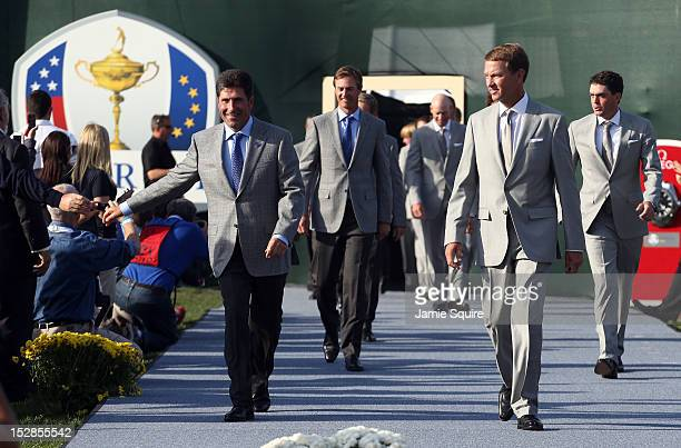 Ryder Cup captains Jose Maria Olazabal and Davis Love III lead their teams in during the Opening Ceremony for the 39th Ryder Cup at Medinah Country...