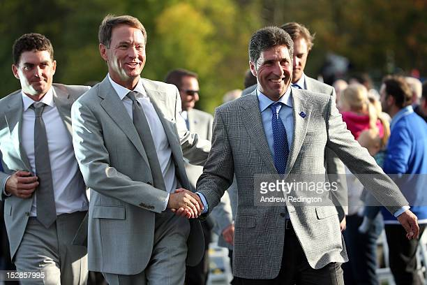 Ryder Cup captains Jose Maria Olazabal and Davis Love III shake hands as they lead their teams into the Opening Ceremony for the 39th Ryder Cup at...