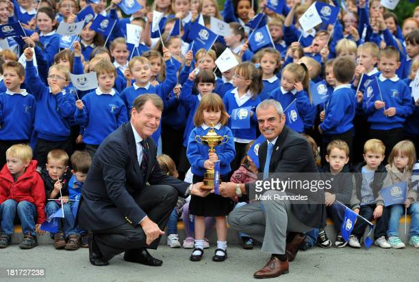 Ryder Cup Europe Captain Paul McGinley and USA Captain Tom Watson pose with primary school pupil Holly Munro during the launch of a Ryder Cup...