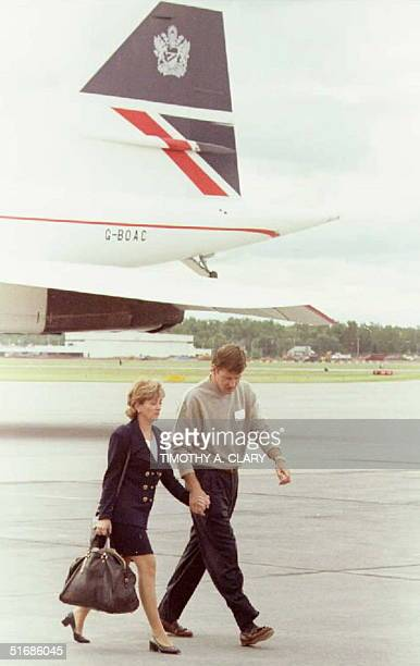 Ryder Cup European team member Nick Faldo of England walks across the tarmac with his wife Gill after greeting his wife and teammates as they arrived...